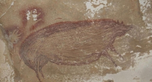 Indonesia: Archaeologists find world's oldest animal cave painting - BBC News